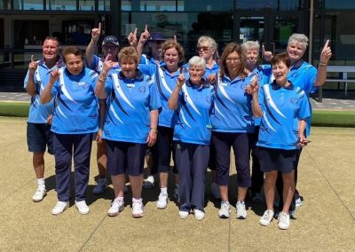 Division three south west champions with their index fingers up